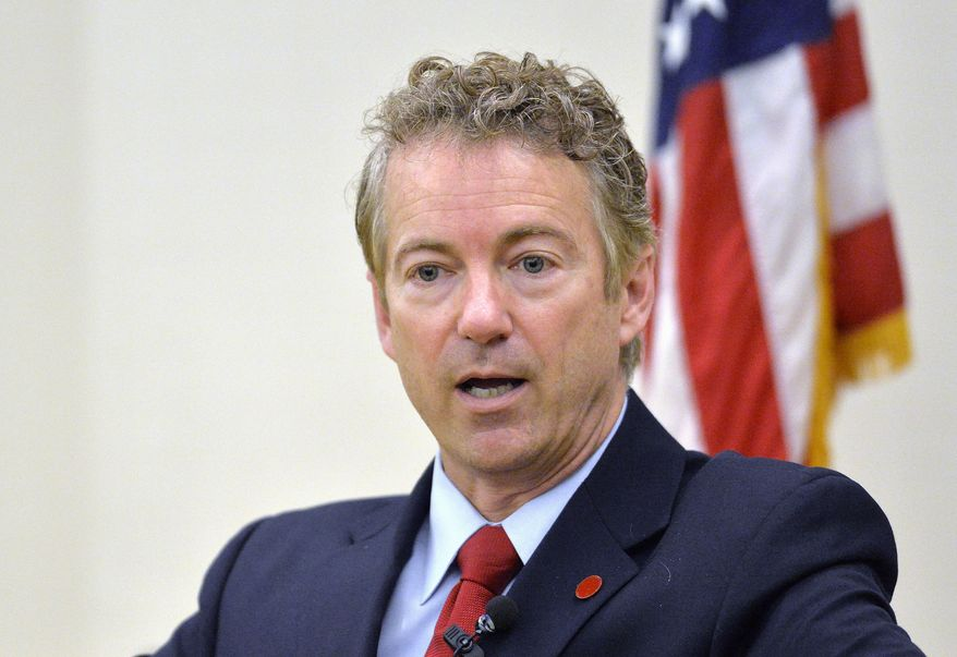 FILE - In this Nov. 21, 214 file photo, Sen. Rand Paul, R-Ky. speaks in Highland Heights, Ky.  The presidential contest that's starting to take shape is exposing divisions among likely Republican candidates on the nation's role in global affairs. Among those outlining foreign policy this week: Bush, Rand Paul, Ted Cruz and Bobby Jindal, as well as the party's 2008 presidential nominee, Sen. John McCain. (AP Photo/Timothy D. Easley, File)