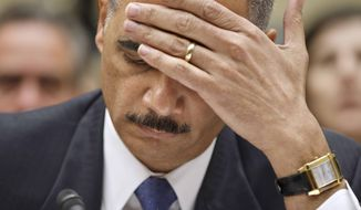 Attorney General Eric H. Holder Jr. puts his hand to his face while testifying on Capitol Hill in Washington on Thursday, Feb. 2, 2012. Associated Press photo.