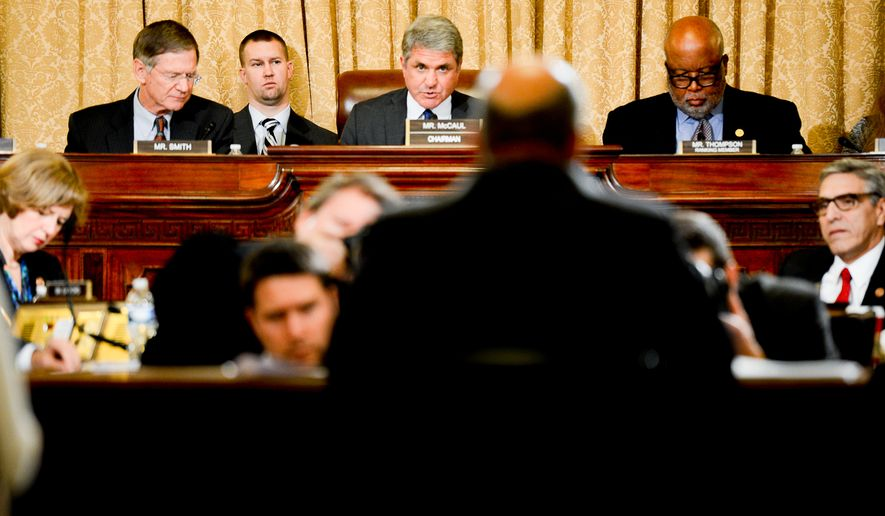 "Chairman Michael McCaul (R-Texas), center, questions U.S. Secretary of Homeland Security Jeh Johnson, foreground, as he testifies on ""the Impact of Presidential Amnesty on Border Security"" in front of the House Committee on Homeland Security on Capitol Hill, Washington, D.C., Tuesday, December 2, 2014. (Andrew Harnik/The Washington Times)"