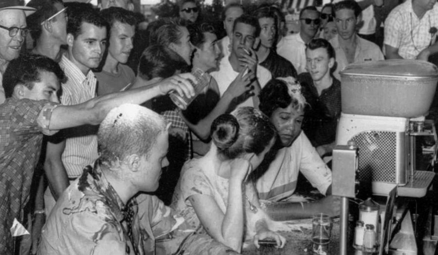 In this May 28, 1963, file photograph, a group of whites poured sugar, ketchup and mustard over the heads of Tougaloo College student demonstrators at a sit-in demonstration at a Woolworth's lunch counter in downtown Jackson, Miss. (AP Photo/Jackson Daily News, Fred Blackwell, File) ** FILE **