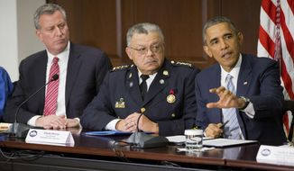 President Barack Obama, right, speaks during his meeting with elected officials, law enforcement officials and community and faith leaders in the Old Executive Office Building on the White House Complex in Washington, Monday, Dec. 1, 2014. Obama said that in the wake of the shooting of an unarmed 18-year-old man in Ferguson, Missouri, he wants to make sure to build better trust between police and the communities they serve. Also at the meeting are New York Mayor Bill de Blasio, left, and Charles Ramsey, center, Commissioner of the Philadelphia Police Dept. (AP Photo/Pablo Martinez Monsivais) **FILE**