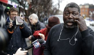 Benjamin Carr, stepfather of Eric Garner, talks on the phone and to reporters after a grand jury's decision not to indict a New York police officer involved in Garner's death, Wednesday, Dec. 3, 2014, in the Staten Island borough of New York. The decision not to indict Officer Daniel Pantaleo added to the tensions that have simmered in the city since Garner's death on July 17. (AP Photo/Seth Wenig)