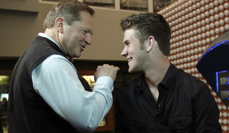 Baseball player Bryce Harper, right, talks to his advisor Scott Boras after an interview in Newport Beach, Calif., Monday, June 7, 2010. The Washington Nationals selected junior college slugger Bryce Harper with the No. 1 overall pick in the baseball draft Monday night. (AP Photo/Jae C. Hong)