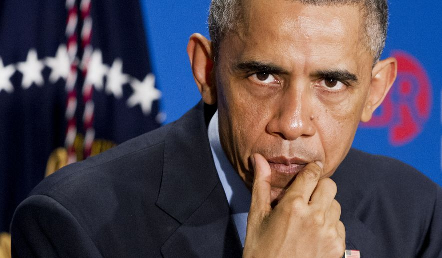 President Obama's unilateral immigration action, announced Nov. 20, would grant tentative status and work permits to nearly 5 million illegal immigrants, and would remove many others from any danger of deportation — though they would not have the same legal status as those officially granted the amnesty. (Associated Press)