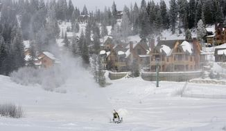 FILE - In this photo taken on Dec. 17, 2010, Tamarack Resort in Donnelly, Idaho, makes snow in preparation for its opening day.  Not long after the recession put the skids on skiing like an unwaxed board in heavy crud, Sun Valley, Brundage and Tamarack resorts are applying a fresh coat and hoping to slide into a smoother future.(AP Photo/Idaho Statesman, Katherine Jones, file)