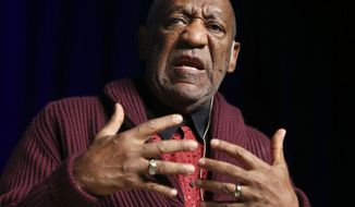 In this Nov. 6, 2013, file photo, comedian Bill Cosby performs at the Stand Up for Heroes event at Madison Square Garden in New York. Three women who claim they were victimized by Cosby are scheduled to appear at a news conference called by attorney Gloria Allred, on Wednesday, Dec. 3, 2014. (John Minchillo/Invision/AP, File) ** FILE **