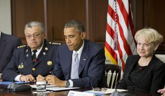 President Barack Obama, center, seated with Laurie Robinson, right, Clarence J. Robinson Professor of Criminology, Law, & Society at George Mason University, and Charles Ramsey, left, Commissioner Philadelphia Police Dept., during his meeting with elected officials, law enforcement officials and community and faith leaders in the Old Executive Office Building on the White House Complex in Washington, Monday, Dec. 1, 2014. At the meeting it was announced that Ramsey and Robinson will co-chair President Obama's Task Force on 21st Century Policing. (AP Photo/Pablo Martinez Monsivais) **FILE**