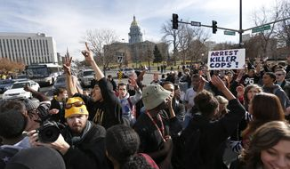 East High School students in Denver participate in a protest against the Ferguson, Missouri grand jury decision, in a busy intersection in front of the state Capitol, Wednesday Dec. 3, 2014. (AP Photo/Brennan Linsley) **FILE**