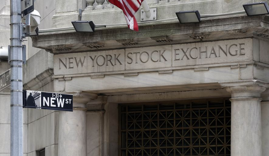 The Wall Street entrance of the New York Stock Exchange, Thursday, Oct. 2, 2014. Global stock markets drifted higher Wednesday Dec. 2, 2014 after Chinese business surveys offered some optimism about the world's No. 2 economy. (AP Photo/Richard Drew)