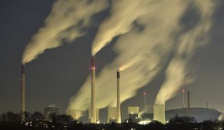 In this Monday, Nov. 24, 2014 file photo, smoke streams from the chimneys of the E.ON coal-fired power station in Gelsenkirchen, Germany, and with a capacity of around 2300 MW of power it is one of the most powerful coal-fired power stations in Europe. Germany announced on Wednesday, Dec. 3, 2014 a cash boost for measures to cut greenhouse gas emissions, in a bid to meet its ambitious climate target for 2020. Germany has pledged to reduce its carbon dioxide output by 40 percent by the end of the decade, compared to 1990s levels. Current estimates predict it will only achieve a 32-35 percent cut. (AP Photo/Martin Meissner, File)FILE -