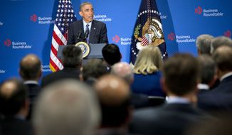 President Barack Obama speaks to leading CEOs to discuss ways to promote the economy and create jobs during his last two years in office, Wednesday, Dec. 3, 2014, at the Business Roundtable Headquarters in Washington. (AP Photo/Jacquelyn Martin)