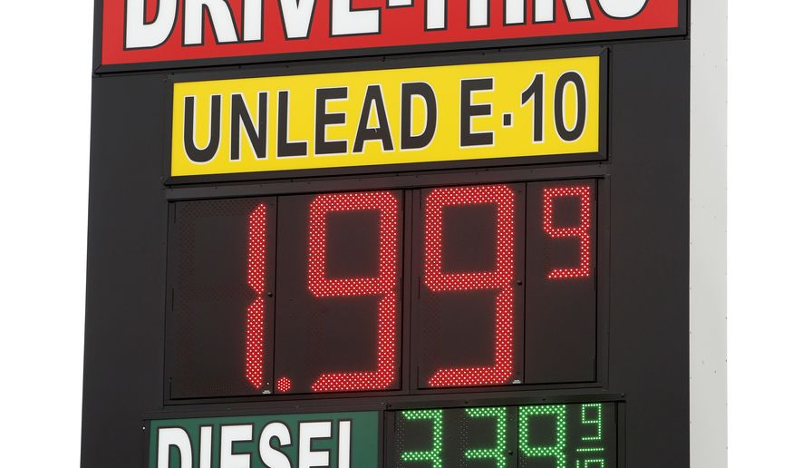 A sign displays the price for E-10 gasoline for $1.99 at the OnCue convenience store and gas station, Wednesday, Dec. 3, 2014, in Oklahoma City. (AP Photo/The Oklahoman, Paul B. Southerland) LOCAL STATIONS OUT (KFOR, KOCO, KWTV, KOKH, KAUT OUT); LOCAL WEBSITES OUT; LOCAL PRINT OUT (EDMOND SUN OUT, OKLAHOMA GAZETTE OUT) TABLOIDS OUT