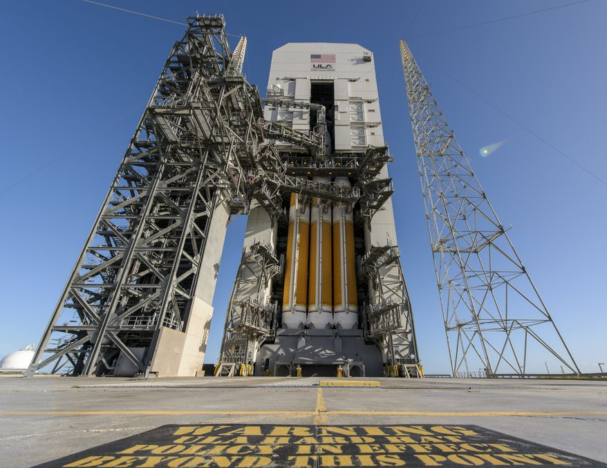 In a photo provided by NASA, the Orion space capsule is seen atop a Delta IV rocket ready for a test launch at the Cape Canaveral Air Force Station. (AP Photo/NASA, Bill Ingalls)