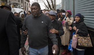 Benjamin Carr, relative of Eric Garner, leaves the district attorney's office after a grand jury's decision not to indict a New York police officer involved in the death of Garner, Wednesday, Dec. 3, 2014, in the Staten Island borough of New York.  A video shot by an onlooker and widely viewed on the Internet showed the 43-year-old Garner telling a group of police officers to leave him alone as they tried to arrest him. The city medical examiner ruled Garner's death a homicide and found that a chokehold contributed to it. (AP Photo/John Minchillo)