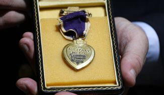 "Victims of the Fort Hood shooting will soon be eligible to receive the Purple Heart, with Congress pushing ahead with a policy change that would officially recognize domestic terrorism as an issue, rather than the ""workplace violence"" designation the Obama administration had used. (Associated Press) **FILE**"