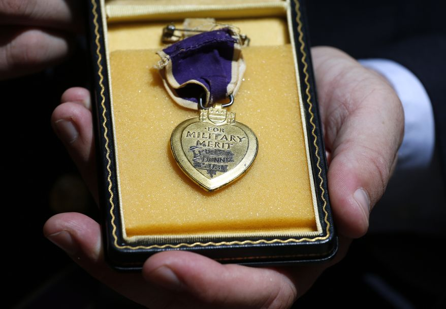 """Victims of the Fort Hood shooting will soon be eligible to receive the Purple Heart, with Congress pushing ahead with a policy change that would officially recognize domestic terrorism as an issue, rather than the """"workplace violence"""" designation the Obama administration had used. (Associated Press) **FILE**"""