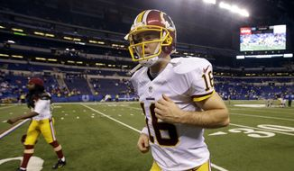 Washington Redskins quarterback Colt McCoy runs off the field following an NFL football game against the Indianapolis Colts, Sunday, Nov. 30, 2014, in Indianapolis. The Colts defeated the Redskins 49-27. (AP Photo/Darron Cummings)