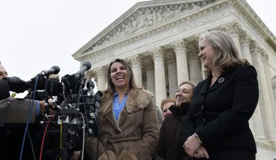 Peggy Young, a Virginia woman who lost her UPS job because she became pregnant, left, accompanied Marcia Greenberger, founder and co-president of the National Women's Law Center, center, and Young's attorney, Sharon Fast Gustafson, right, speaks to reporters outside the Supreme Court in Washington, Wednesday, Dec. 3, 2014. (AP Photo/Susan Walsh)