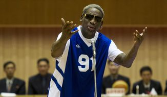 "Dennis Rodman sings ""Happy Birthday"" to North Korean leader Kim Jong-un, seated above in the stands, before an exhibition basketball game at an indoor stadium in Pyongyang, North Korea on Wednesday, Jan. 8, 2014. (AP Photo/Kim Kwang Hyon, File)"