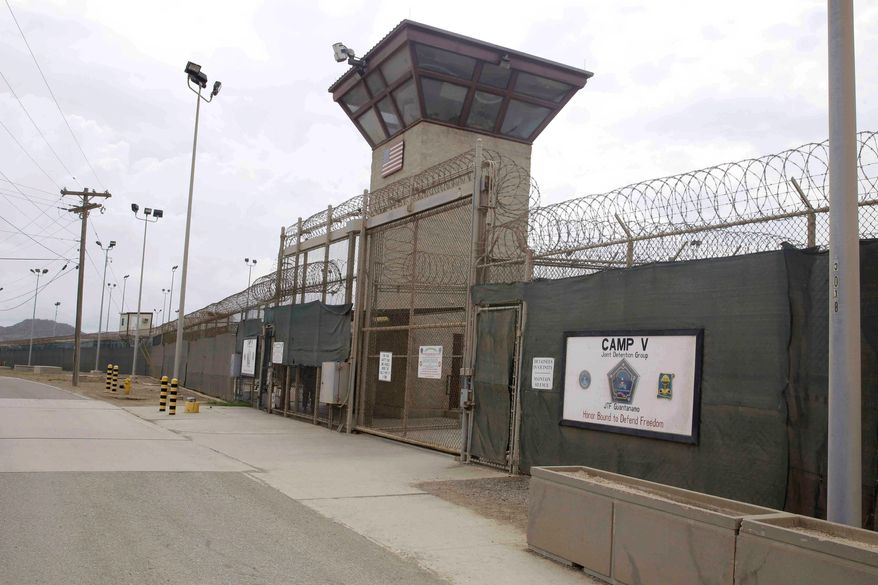 Despite many items on the chopping block, Congress' 2014 year-end defense spending bill maintains funding for the U.S. military's Guantanamo Bay detention center, which President Obama vowed to close as part of his 2008 campaign promises. (associated press)