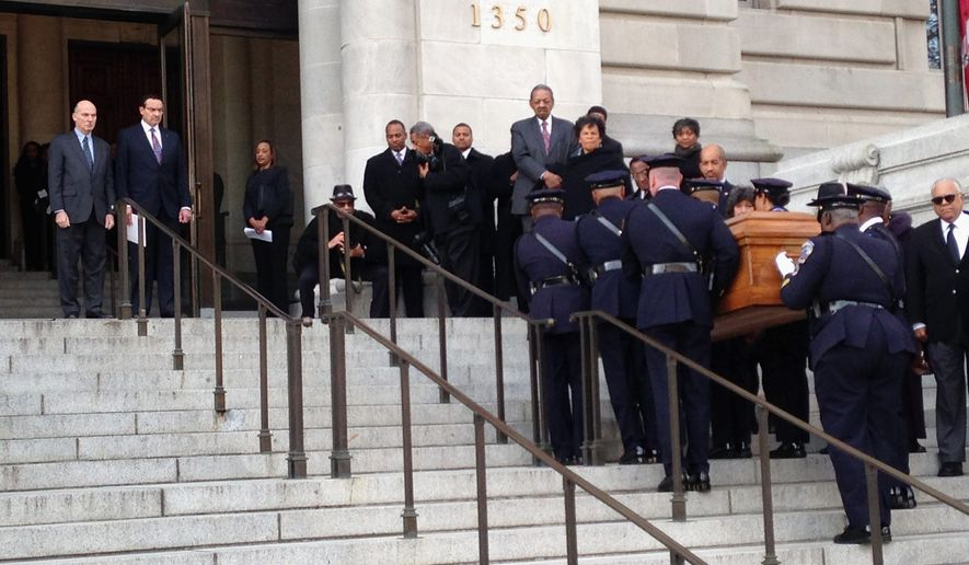 District officers carry the casket of former Mayor Marion Barry up the steps of the John A. Wilson Building, Thursday to be greeted by Mayor Vincent Gray and Council Chairman Phil Mendelson. Mr. Barry's remains were to lie in repose for 24 hours before a procession Friday to The Temple of Praise church. A viewing is scheduled Saturday at the convention center. (Associated Press)