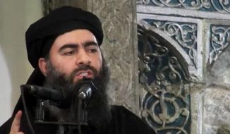 This file image made from video posted on a militant website Saturday, July 5, 2014, which has been authenticated based on its contents and other AP reporting, purports to show the leader of the Islamic State group, Abu Bakr al-Baghdadi, delivering a sermon at a mosque in Iraq. (AP Photo/Militant video, File)