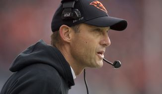 Oregon State head football coach Mike Riley during an NCAA college football game against Washington State in Corvallis, Ore., Saturday, Nov. 8, 2014. (AP Photo/Troy Wayrynen)