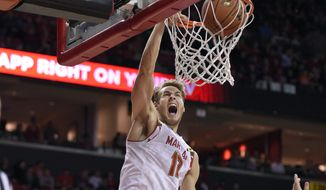 Maryland guard/forward Jake Layman (10) dunks against Virginia guard Justin Anderson (1) during the second half of an NCAA college basketball game, Wednesday, Dec. 3, 2014, in College Park, Md. Virginia won 76-65. (AP Photo/Nick Wass)