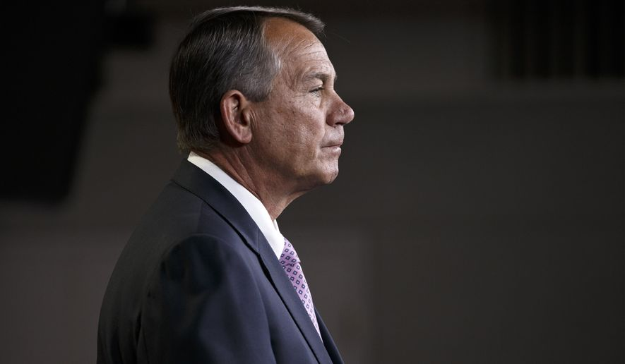 House Speaker John Boehner of Ohio meets with reporters on Capitol Hill in Washington, Thursday, Dec. 4, 2014.  Just days before government funding expires, House Republican leaders are trying to strike a balance between the conservatives determined to stop President Barack Obama's immigration order and other lawmakers just as determined to avoid another politically damaging shutdown. (AP Photo/J. Scott Applewhite)
