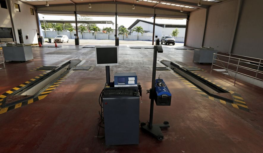 ADVANCE FOR MONDAY, DEC. 8 AND THEREAFTER - In this Thursday, Sept. 18, 2014 photo, an automobile emissions test facility stands empty while waiting for customers in Panama City. The energy-efficiency push is all but absent in Panama, where gasoline sells for about $1 a gallon. The country has the lowest fuel taxes in Central America. It has no refineries, so it imports all fuel but charges no tariffs on it. The government discounts the price because the fuel is dirtier than what foreign refiners charge for cleaner blends of U.S. gasoline. It requires a blend with 5 percent sugarcane ethanol and has tree-planting programs to counter deforestation. Among the things they are not enforcing are tailpipe tests aimed at making sure cars are running efficiently and releasing the least amount of pollution. The workers and owners said no one comes for the $16 test. (AP Photo/Arnulfo Franco)