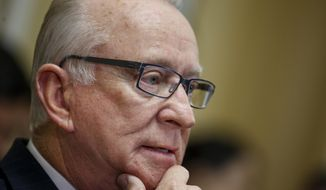 "In this photo taken Dec. 3, 2014, House Armed Services Committee Chairman Rep. Howard ""Buck"" McKeon, R-Calif. listens on Capitol Hill in Washington.  House passes defense bill backing Obama's expansion of military operations against extremists  (AP Photo/J. Scott Applewhite)"