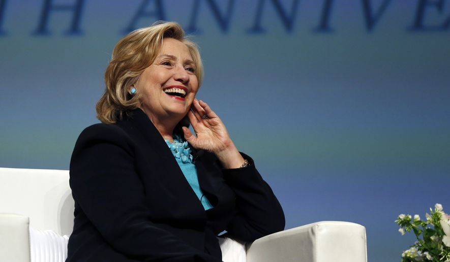"""Former Secretary of State Hillary Rodham Clinton laughs when asked what would be good qualities for a """"First Gentleman"""" during a question and answer session at the Massachusetts Conference for Women in Boston, Thursday, Dec. 4, 2014. (AP Photo/Elise Amendola)"""