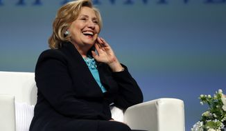 "Former Secretary of State Hillary Rodham Clinton laughs when asked what would be good qualities for a ""First Gentleman"" during a question and answer session at the Massachusetts Conference for Women in Boston, Thursday, Dec. 4, 2014. (AP Photo/Elise Amendola)"