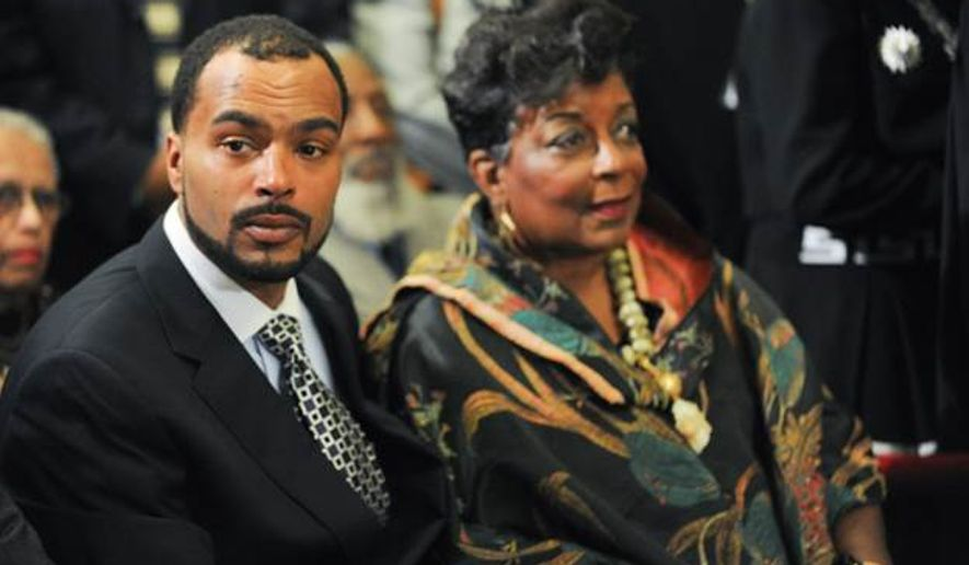 Christopher Barry and step mom Cora Masters Barry at a Thursday, Dec. 4, 2014, service for the late Marion Barry. (Photo courtesy of the Executive Office of the Mayor)