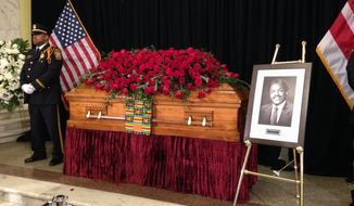 A casket containing the remains of former District of Columbia Mayor Marion Barry sits in the front lobby of the John A. Wilson Building, the District's city hall, where Barry spent 16 years as mayor and another 16 years on the D.C. Council, Thursday, Dec. 4, 2014, in Washington. Barry died Nov. 23 at age 78. His remains were brought to the Wilson Building Thursday morning to lie in repose for 24 hours before a funeral procession and two memorial services. (AP Photo/Ben Nuckols)