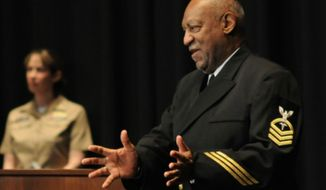 Bill Cosby is presented with the title Honorary Chief Hospital Corpsman in 2011. (U.S. Navy)