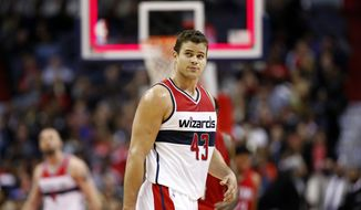 Washington Wizards forward Kris Humphries (43) walks off the court at the end of the first half of an NBA basketball game against the New Orleans Pelicans, Saturday, Nov. 29, 2014, in Washington. (AP Photo/Alex Brandon)