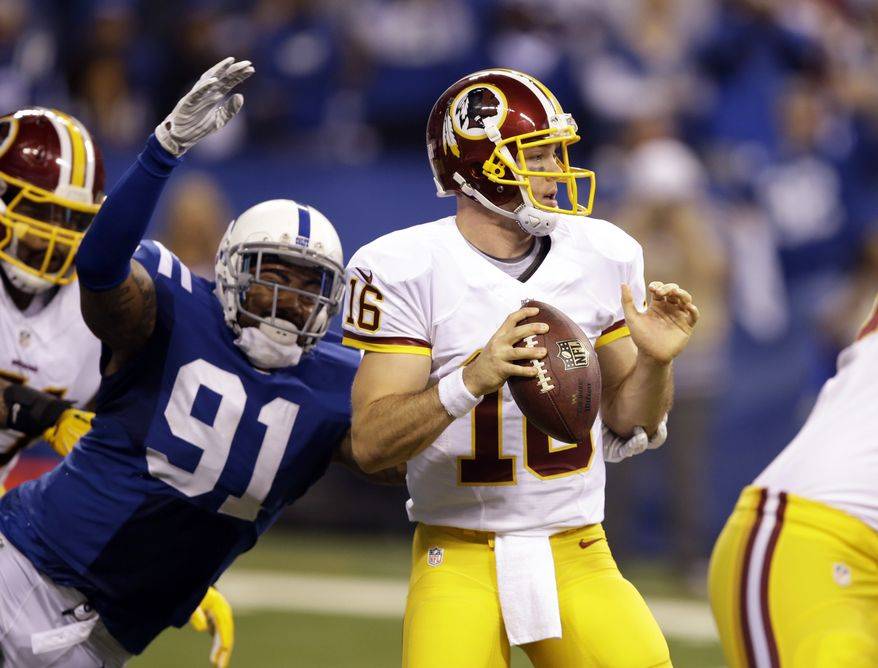 Indianapolis Colts linebacker Jonathan Newsome, left, drives to sack Washington Redskins quarterback Colt McCoy during the first half of an NFL football game Sunday, Nov. 30, 2014, in Indianapolis. (AP Photo/Darron Cummings)