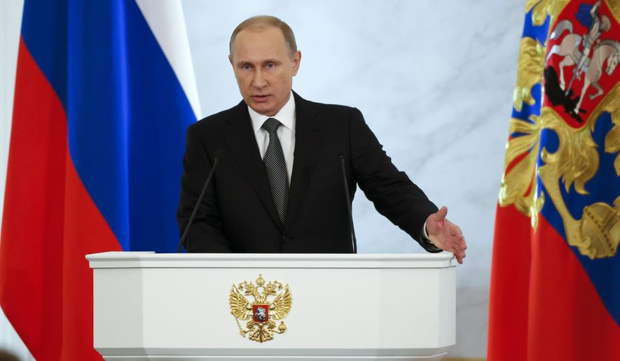 Russian President Vladimir Putin gives his annual state of the nation address in the Kremlin in Moscow, Russia, Thursday, Dec. 4, 2014. Russian President Putin has defended the Kremlin's aggressive foreign policy, saying the actions are necessary for his country's survival. (AP Photo/Pavel Golovkin)