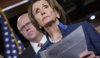 House Minority Leader Nancy Pelosi of Calif., joined by Rep. Joe Crowley, D-N.Y., holds a news conference on Capitol Hill in Washington, Thursday, Dec. 4, 2014, about the looming fight over terrorism insurance. As Congress races to its lame-duck finish, time is running out on a government program that provides a backstop to private-sector insurance against terrorist attacks.The program was enacted after the Sept. 11 attacks and has been renewed twice.  (AP Photo/J. Scott Applewhite)