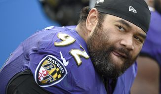 Baltimore Ravens defensive end Haloti Ngata (92) watches the action from the sidelines during the second half of an NFL football game against the Tennessee Titans in Baltimore, Sunday, Nov. 9, 2014. (AP Photo/Nick Wass)