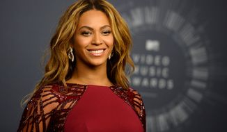 """FILE - In this Aug. 24, 2014 file photo, Beyonce poses in the press room at the MTV Video Music Awards at The Forum in Inglewood, Calif. British newcomer Sam Smith and Beyonce - the most nominated female in Grammy history _ are the current leaders at the Grammy Awards with five each. Smith and Beyonce will likely earn nominations for album of the year, the top award, when The Recording Academy announces the nominees Friday night, Dec. 5, 2014, on """"A Very GRAMMY Christmas"""" (9 p.m., CBS). (Photo by Jordan Strauss/Invision/AP, File)"""