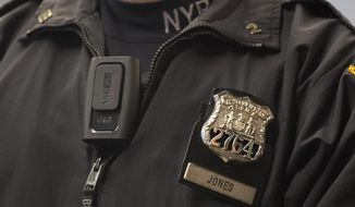 New York Police Department officer Joshua Jones wears a VieVu body camera on his chest during a news conference, Wednesday, Dec. 3, 2014 in New York. The nation's largest police department is beginning with an experimental deployment of the cameras which will record encounters between police and civilians. (AP Photo/Mark Lennihan) **FILE**