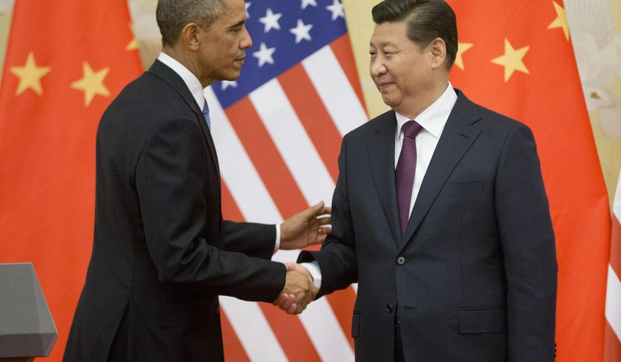 FILE - In this Nov. 12, 2014 file photo, President Barack Obama shakes hands with  Chinese President Xi Jinping at the conclusion of their joint news conference at the Great Hall of the People in Beijing. Six countries produce nearly 60 percent of global carbon dioxide emissions. China and the United States combine for more than two-fifths. The planet's future will be shaped by what these top carbon polluters do about the heat-trapping gases blamed for global warming.  (AP Photo/Pablo Martinez Monsivais, File)