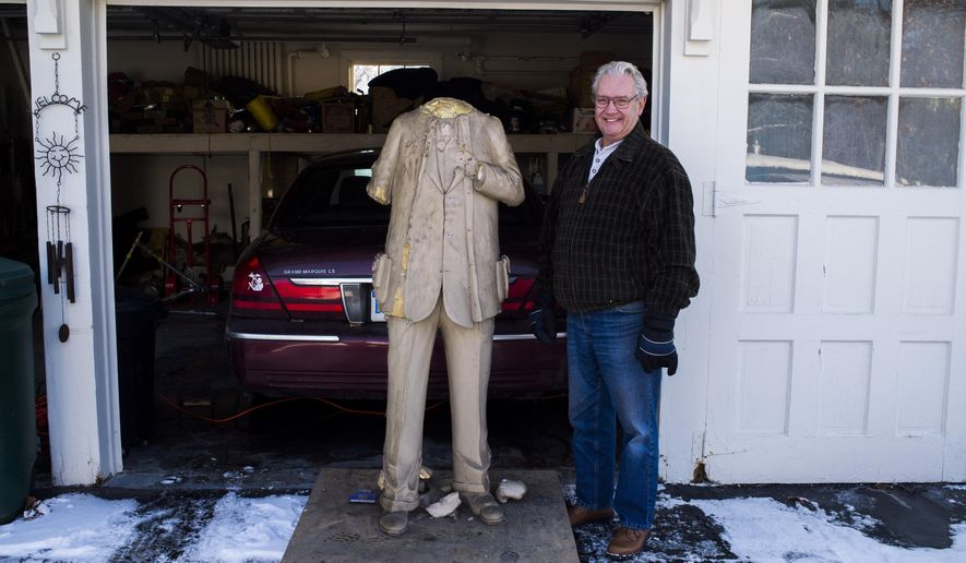 "In a Nov. 21, 2014 photo, the remains of a statue of William ""Billy"" Durant stand outside of the garage of sculptor Joe Rundell in Flint, Mich. Rundell, the official sculptor for Back to the Bricks, receives the statues back after a bronze is made for display, which he then refurbishes and prepares for future displays. (AP Photo/The Flint Journal, Jake May) LOCAL TELEVISION OUT; LOCAL INTERNET OUT"