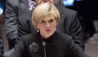 In this Sept. 19, 2014 file photo, Australian Foreign Minister Julie Bishop addresses a meeting of the U.N. Security Council on Iraq at the United Nations headquarters. Australia will continue to directly pay for climate change adaptation in vulnerable South Pacific island nations through its aid budget rather than donate to a U.N. Green Climate Fund designed for the same purpose, Bishop said Friday, Dec. 5, ahead of climate talks in Peru. (AP Photo/Bebeto Matthews, File)-FILE