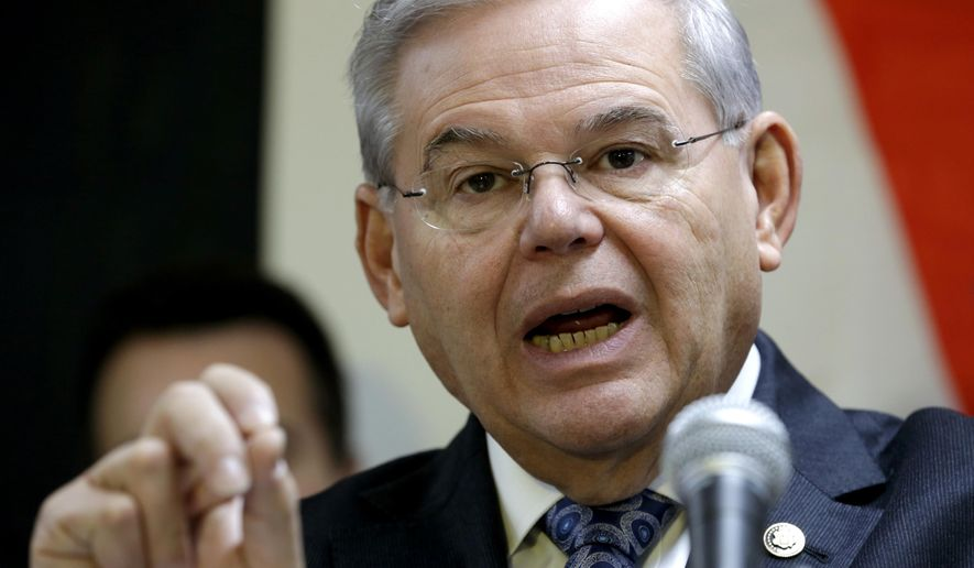 U.S. Sen. Robert Menendez talks during a news conference at the Secaucus Public Safety Marina, Friday, Dec. 5, 2014, in Secaucus, N.J. The Federal Emergency Management Administration has approved $440,000 in funding to repair the marina, which serves both the Secaucus Fire Department Marine Unit and the U.S. Coast Guard Auxiliary Flotilla 32 and was damaged by Superstorm Sandy. (AP Photo/Julio Cortez)