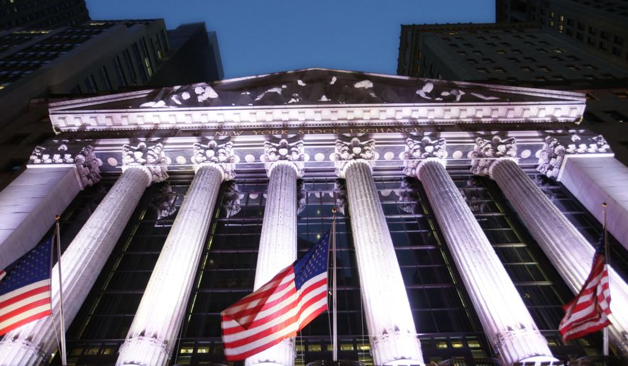 In this Wednesday, Oct. 8, 2014, photo, American flags fly in front of the New York Stock Exchange, in New York. (AP Photo/Mark Lennihan) ** FILE **