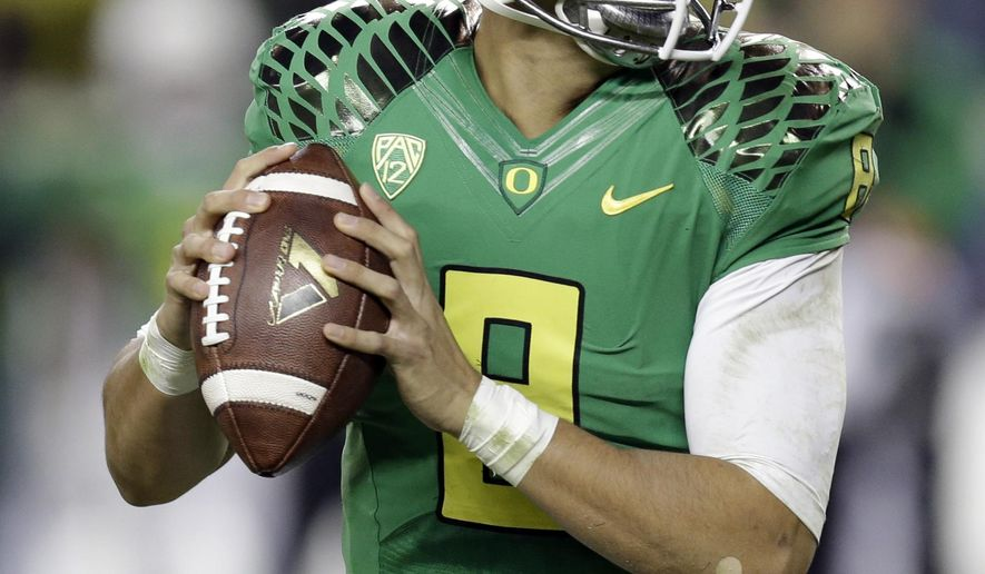 Oregon quarterback Marcus Mariota drops back to pass against Arizona during the second half of a Pac-12 Conference championship NCAA college football game Friday, Dec. 5, 2014, in Santa Clara, Calif. Oregon won the game, 51-13. (AP Photo/Ben Margot)