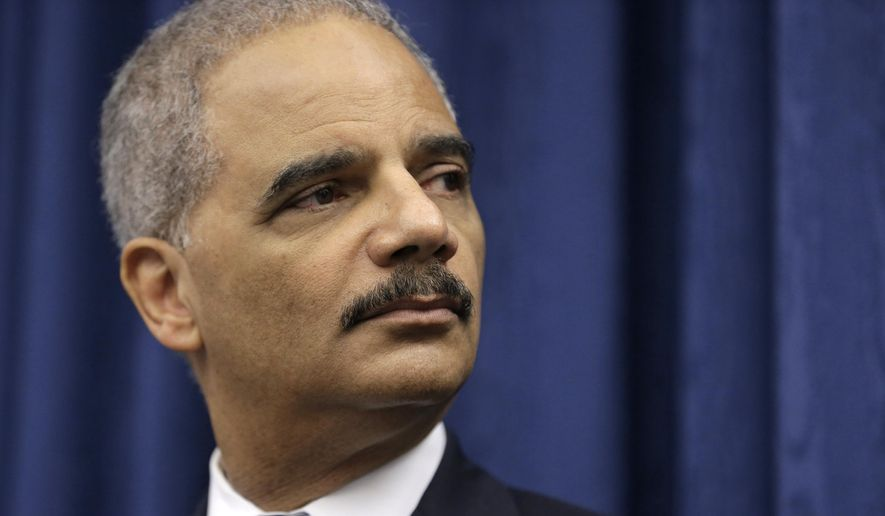 U.S. Attorney General Eric Holder speaks during a news conference before a roundtable meeting in Cleveland in this Thursday, Dec. 4, 2014, file photo. (AP Photo/Tony Dejak) ** FILE **